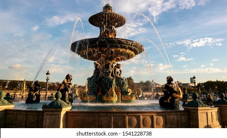 Paris France - October 25, 2017: Scenic cityscape of the Parisian fountain on a sunny day. Young people like to take a photo near famous beautiful fountain in the Place de la Concorde (Concord Square)