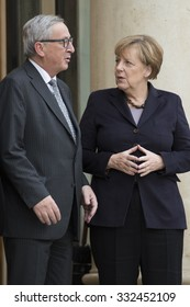 PARIS, FRANCE - OCTOBER 27, 2015 : Jean-Claude Juncker and Angela Merkel at the Elysee Palace for a digital conference in the context of European Round Table of Industrialist.