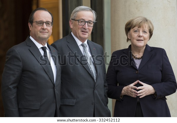 PARIS, FRANCE - OCTOBER 27, 2015 : Francois Hollande, Jean-Claude Juncker and Angela Merkel at the Elysee Palace for a digital conference in the context of European Round Table of