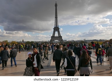 PARIS, FRANCE - OCTOBER 27 2018: people in Place du Trocadero with a sight of the Eiffel tower in the background