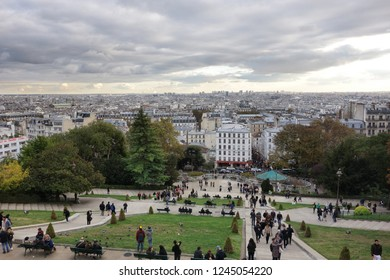 PARIS, FRANCE - OCTOBER 27 2018:  people on the stairs of Basilica of Sacre Coeur de Montmartre, City overview at sunset