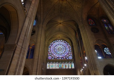 PARIS, FRANCE - OCTOBER 27 2018: Rose Window in the famous Notre Dame de Paris, Gothic Interior of the Cathedral example of Rayonnant architecture
