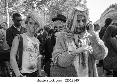 PARIS, FRANCE - OCTOBER 3, 2015: Zombie participant making call phone home or to friends with his mobile phone during Zombie parade at Place de la Republique. Zombie Walk is an annual event in Paris.