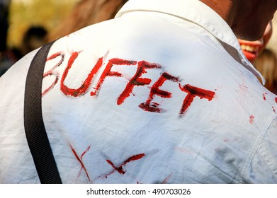 PARIS, FRANCE - OCTOBER 3, 2015: Zombie man with inscription Buffet on his shirt  participating in Zombie parade at Place de la Republique. Zombie Walk is an annual event in Paris.