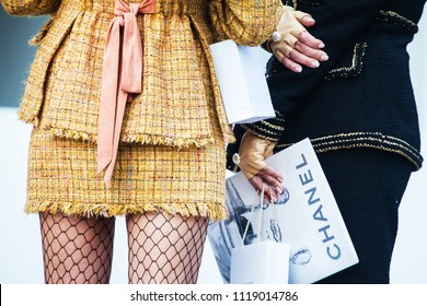 Paris. France - October 3, 2017: Street fashion photo of details womens clothes and shoes. A girl in stylish clothes with a Chanel bag on the Champs Elysees avenue in Paris.
