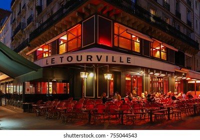 PARIS, FRANCE - OCTOBER 30, 2017: Le Tourville night view, a typical French cafe located near the Eiffel tower in Paris, France.