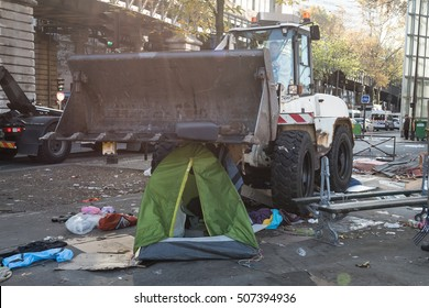 Paris, FRANCE - OCTOBER 31, 2016 : Workers clean an urban migrant camp in northeastern Paris near the Stalingrad subway station after a police operation.