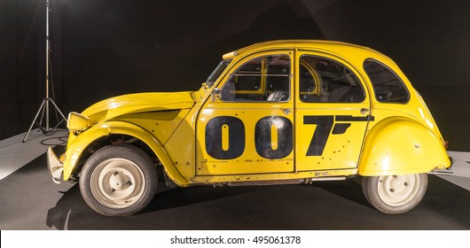 """PARIS, FRANCE - OCTOBER 4, 2016: Peugeot 2CV is displayed in the expositon of """"Cars in cinema"""" during the Paris Motor Show. This car is used in the James Bond movies."""