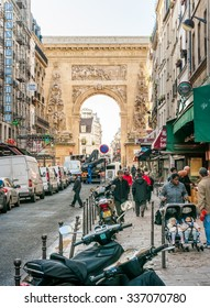 Paris / France - October 5, 2009: The Porte Saint-Denis, built in 1672, was designed by architect Francois Blondel at the order of Louis XIV in honor of his victories on the Rhine and in Franche-Comte