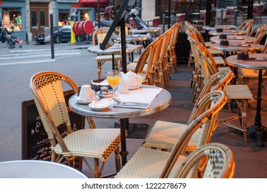 Paris, France - October 6, 2016 - Menu board  and served breakfast outside a french restaurant in the marais district of paris france