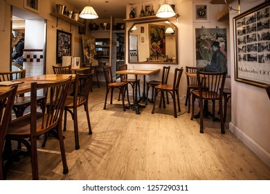 Paris, France -October 6, 2016: The charming Cafe Montmartre on Montmartre hill. Montmartre with traditional french cafes and art galleries is one of the most visited landmarks in Paris.