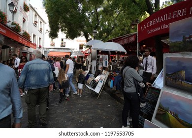 PARIS, FRANCE - OCTOBER 6 2018 - Artist painting and drawing portraits on sunny sunday day in Montmartre Place du Tertre famous artist retreat
