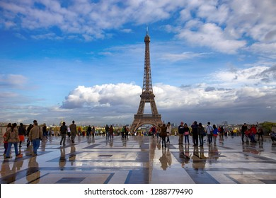 Paris, France. October 7, 2011. Beautiful view of the Eiffel Tower and many tourists in the square in the city