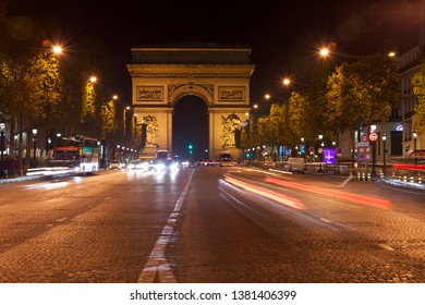 Paris, France, October 7, 2011. Night view of the Avenue des Champs Elysees and Arc de Triomphe