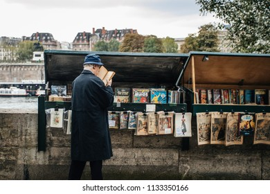 PARIS, FRANCE - October 7, 2016 : Traditional Bouquiniste booth on the edge of the Seine in front of the Notre-Dame cathedral. The Bouquinistes sell used and antique books as well as souvenirs.