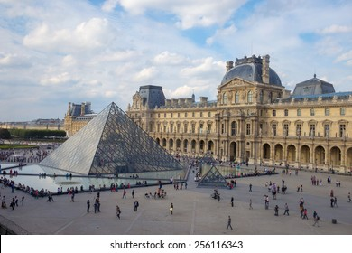 PARIS, FRANCE- October 8 2014: The large glass pyramid and the main courtyard of the Louvre Museum on October 8, 2014.
