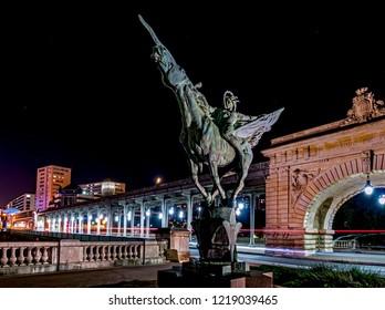 Paris, France - October 8, 2018: France Reborn Statue on Pont de Bir-Hakeim at night.