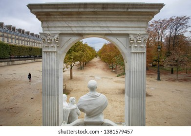 Paris, France, October 9, 2011. Beautiful view through the sculptures and the arch at the autumn in Tuileries Garden
