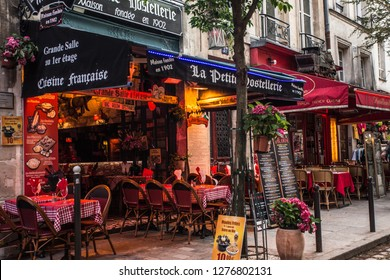 PARIS, FRANCE - OCTOBER 9, 2014:  Street scene from the Latin Quarter, Saint-Michel in Paris France with outdoor cafes and people.