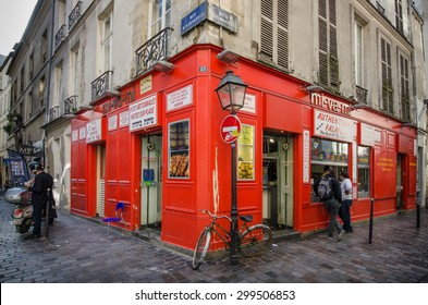 PARIS, FRANCE - OCTOBER 9, 2014: People line up at the window of a popular take-out restaurant mi-va-mi on Rue des Rosiers at the corner of Rue des Ecouffes in the Jewish neighborhood of Marais.