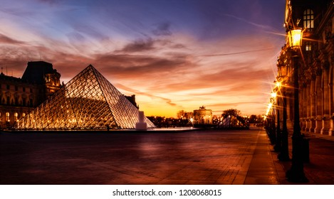 Paris, France on 14/12/2017 - View of famous Louvre Museum with Louvre Pyramid at evening.