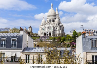 Paris, France, on April 29, 2013. View of Montmartre and cathedral Sakre-Ker from a house window in the sunny spring afternoon