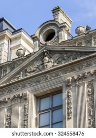 PARIS, FRANCE, on AUGUST 29, 2015. Fragment of one of facades of the royal Louvre palace. Now Louvre is one of the largest museums of the world both the famous architectural and historical monument.