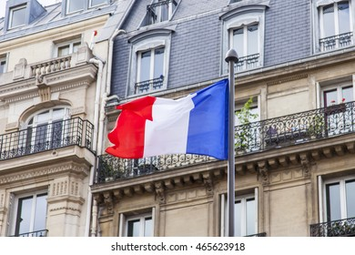 PARIS, FRANCE, on JULY 12, 2016. Urban view. The French flag against typical architecture