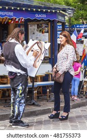 PARIS, FRANCE, on JULY 8, 2016. Montmartre, artists and tourists at Tertr Square