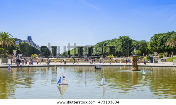 PARIS, FRANCE, on JULY 9, 2016. A picturesque corner near a pond in the Luxembourg garden, the favourite vacation spot of citizens and tourists