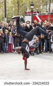 Paris, France, on May 1, 2013. Tourists see a performance of street acrobats on the Champs Elysee