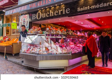 PARIS, FRANCE, on November 1, 2017. Meat and meat products are laid out on a show-window of butcher shop on Muftard Street. People shop