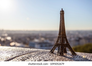 PARIS, FRANCE, on OCTOBER 1, 2016. Montmartre. Eiffel tover souvenit toy on background of sunrise view of the city from the survey platform