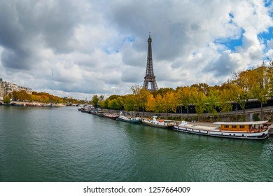 PARIS, FRANCE, on OCTOBER 23, 2018. View of the Seine River, embankment and Eiffel Tower (fr. tour Eiffel)