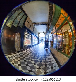 PARIS, FRANCE, on OCTOBER 26, 2018. Interior of a typical old Parisian passage, fisheye view. Show-window of shop of vintage home decoration