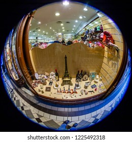 PARIS, FRANCE, on OCTOBER 26, 2018. Interior of a typical old Parisian passage, fisheye view. Show-window of shop of souvenirs