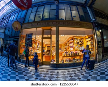 PARIS, FRANCE, on OCTOBER 26, 2018. Interior of a typical old Parisian passage, fisheye view. Show-window of confectionery shop