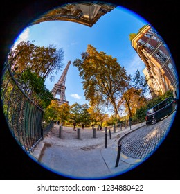 PARIS, FRANCE, on OCTOBER 26, 2018. The beautiful city street around historical building. Eiffel Tower (fr. tour Eiffel) in the distance. Fish-eye view