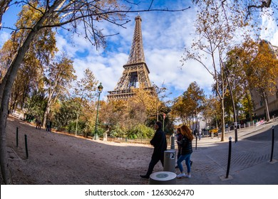 PARIS, FRANCE, on OCTOBER 26, 2018. People walk at the bottom of the Eiffel Tower (fr. tour Eiffel). Fish-eye view