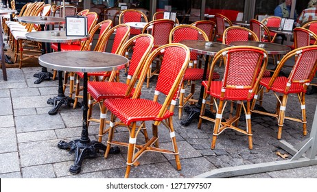 PARIS, FRANCE, on OCTOBER 26, 2018. Typical Parisian street in the morning. Tables of cafe under the open sky on the sidewalk.