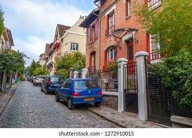 PARIS, FRANCE, on OCTOBER 26, 2018. A city landscape, the street from cottages on the outskirts of the city. cars are parked near the sidewalk
