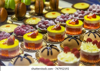PARIS, FRANCE, on October 27, 2017. Various tasty cakes are presented on a show-window of shop for involvement of buyers