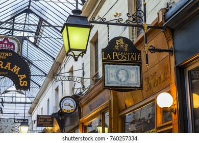 PARIS, FRANCE, on October 27, 2017. Picturesque vintage signs indicate shops and restaurants in the Parisian passage.