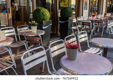 PARIS, FRANCE, on October 27, 2017. The attractive cafe with little tables on the street expects visitors in the morning.
