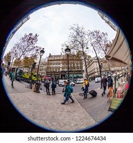 PARIS, FRANCE, on OCTOBER 29, 2018. An urban view in the cloudy autumn morning, people go on a ladder, fisheye view
