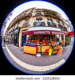 PARIS, FRANCE, on OCTOBER 29, 2018. An urban view, a show-window of shop of vegetables and fruit on the sidewalk, fisheye view