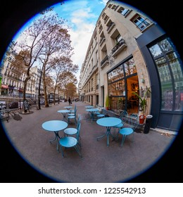PARIS, FRANCE, on OCTOBER 29, 2018. An urban view, little tables of traditional cafe on the sidewalk, fisheye view