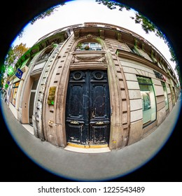 PARIS, FRANCE, on OCTOBER 29, 2018. The typical city street with historical building, an architectural fragment, fisheye view
