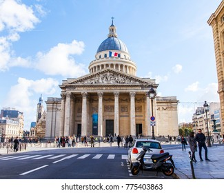 PARIS, FRANCE, on October 30, 2017. Autumn city landscape. Cars and pedestrians go on the beautiful city street. The building of the Pantheon is seen in the distance