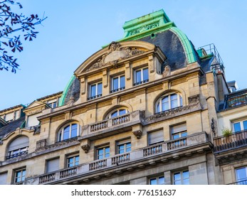 PARIS, FRANCE, on October 30, 2017. The sun lights the city street and typical architectural parts of houses of in downtown. Building facade fragment, typical Parisian mansards